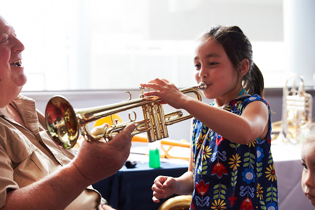 Girl playing a trumpet at Seattle Opera's Summer Fest