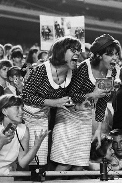 Two Beatles fans, dressing identically, screaming at a concert. Shea Stadium, Queens, New York 1965. Pirate Radio and Sealand and Other stories of Rock, Radio, and Regulations. Marchmatron.com