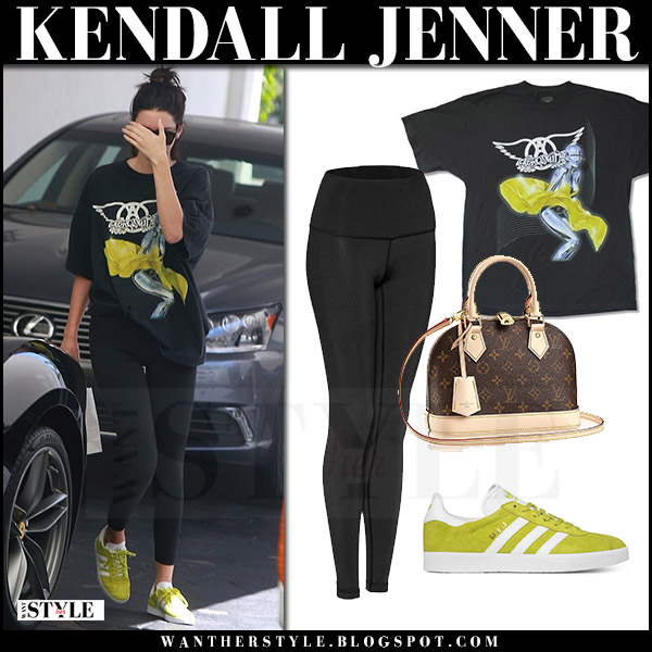Kendall Jenner in black printed t-shirt black leggings lululemon and lime yellow sneakers adidas july 20 2017 streetstyle