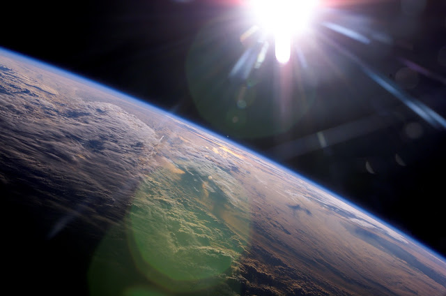 Earth and the Sun seen from the International Space Station