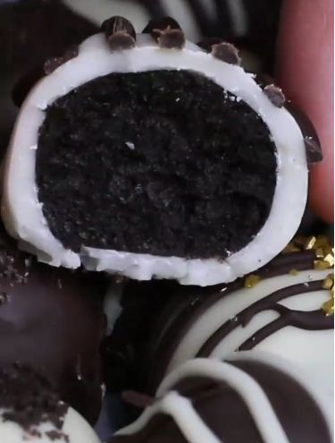 Oreo Cookie Balls are an easy bite-sized no-bake treat: crushed oreo cookies are mixed with cream cheese, and then these oreo balls are covered with chocolate. They are perfect dessert for holidays such as Christmas