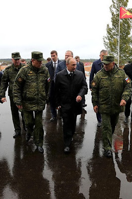 Vladimir Putin with Defense Minister Sergei Shoigu and Chief of the General Staff of Russian Armed Forces Valery Gerasimov.