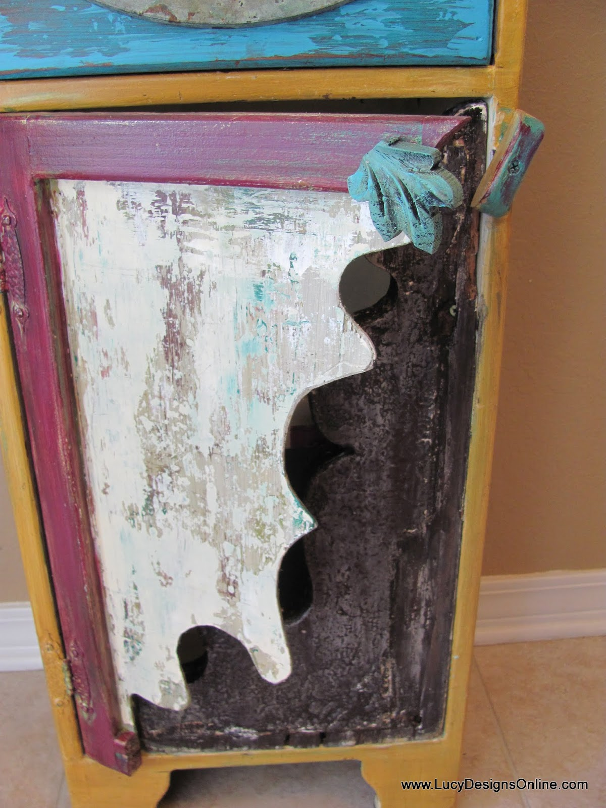 hand painted wooden cabinet with curvy door cutout