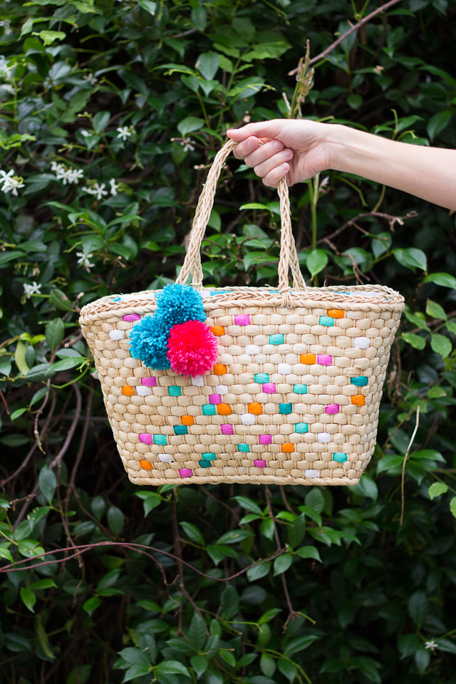 Dress up a plain straw tote with pom-poms and paint - so fun for summer!