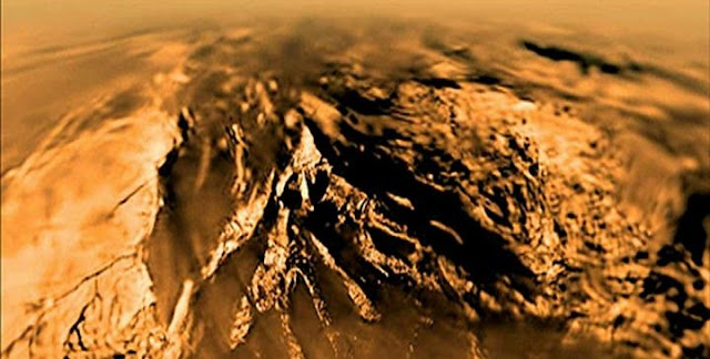 An image of Titan's surface, as taken by the European Space Agency's Huygens probe as it plunged through the moon's thick, orange-brown atmosphere on Jan. 14, 2005. Today, Cornell scientists have chemical evidence that suggests prebiotic conditions may exist there. Credit: ESA/NASA/JPL-Caltech/Univ. of Arizona