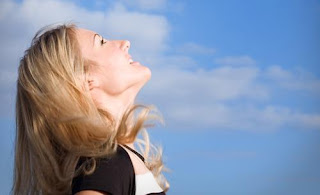 Blonde woman looking at the sky