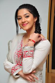 Actress Mehreen Pictures in White Salwar Kameez at Krishna Gadi Veera Prema Gaadha Movie Promotion  0008.jpg