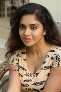 Telugu Actress Karunya Chowdary Stills in Short Dress at ATM Not Working Press Meet  0116.jpg
