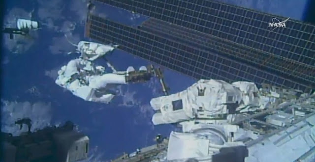 spacewalking astronauts swap iss coolant pumps