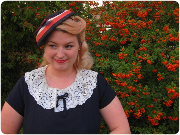 1940s plus size dress with lace collar and victory roll hairstyle with straw vintage hat via Va-Voom Vintage