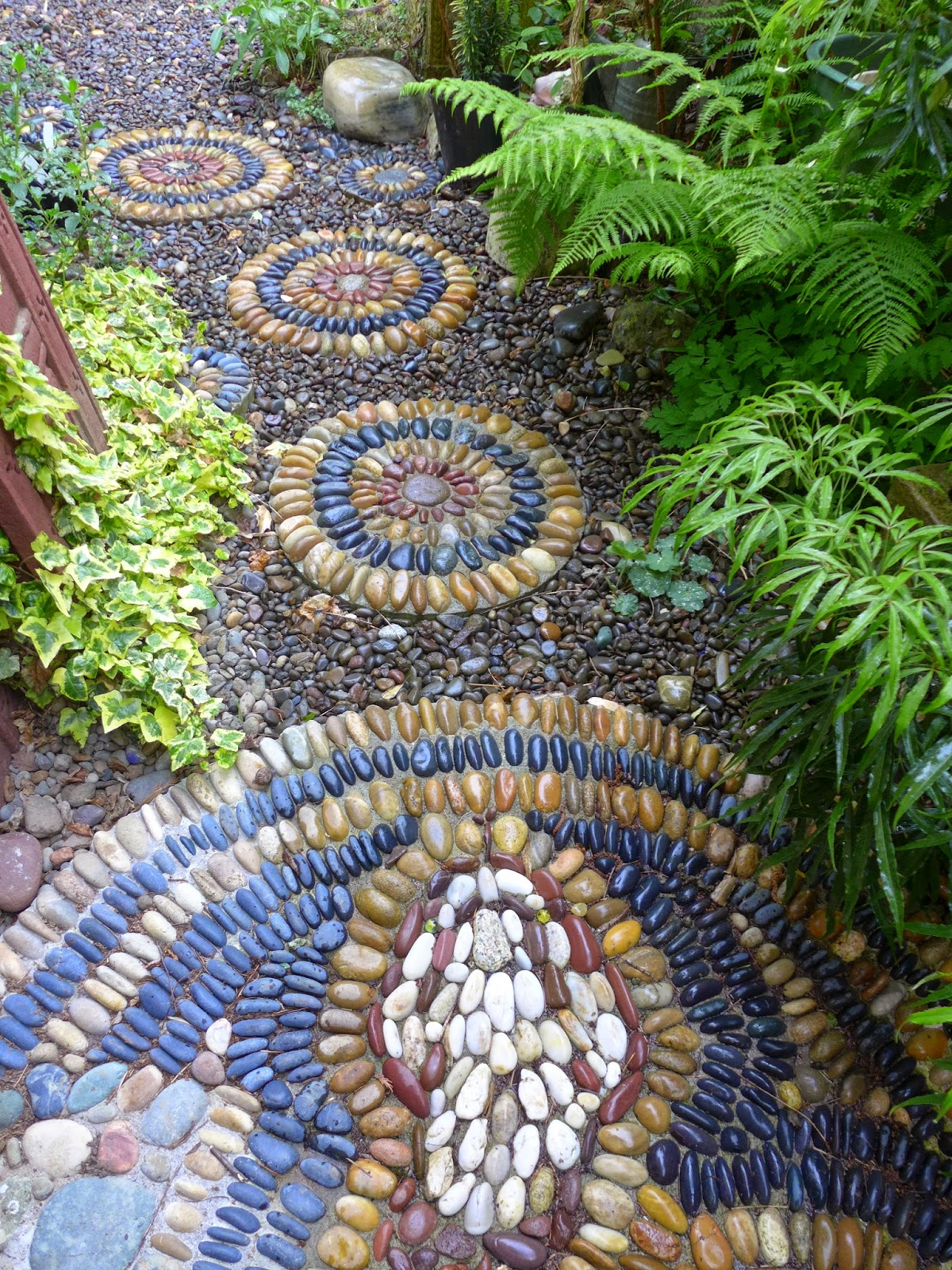 Simple Bands Of Colored Pebbles In Round Stepping Stones Match The Mosaic Path A Rattle Snake Between My Two Houses Smaller Rounds Were Made