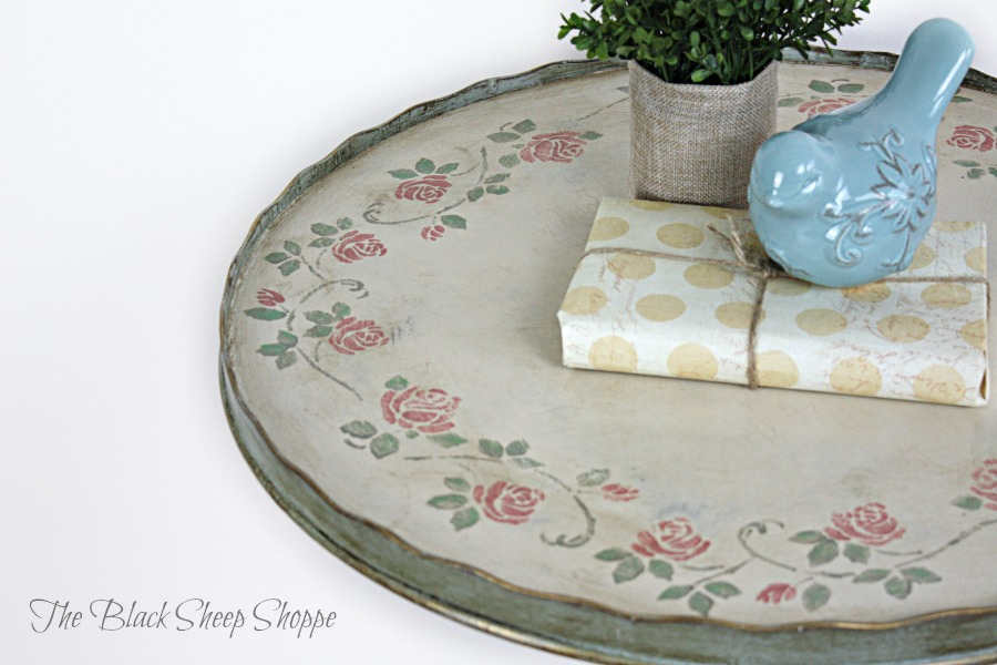A stencil border of flowers was added to the top of the table.