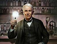 Mucit Thomas Edison ve elinde 1879 yılında icat ettiği ampülü