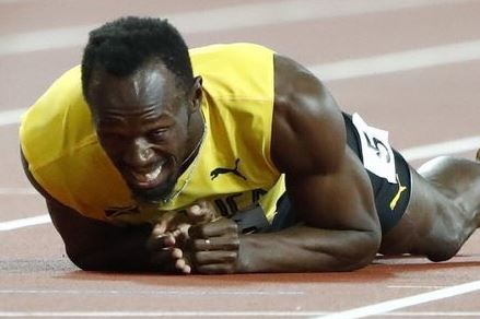 Usain Bolt suffers injury in the final race of his career, breaks down in tears