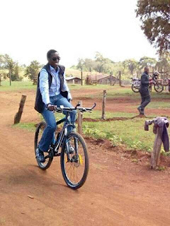Buzeki ridding a bicycle in Uasin Gishu. PHOTO | Courtesy
