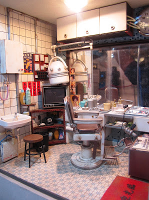 Interior of a miniature Hong Kong barber shop.