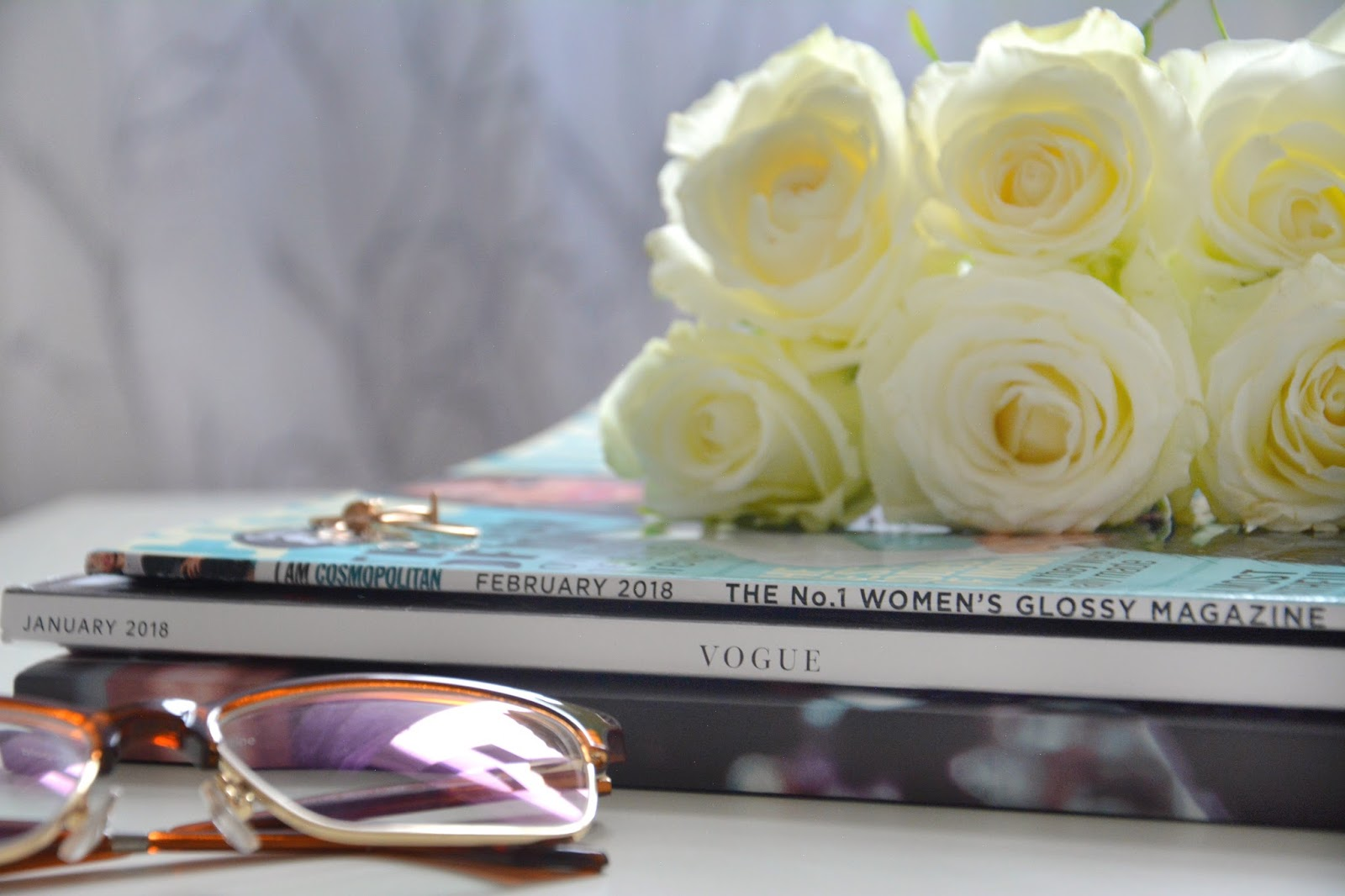 Blogosphere; Vogue; Cosmopolitan; Glasseshop.com Glasses; Huda Beauty Contour & Strobe Set Muse & Angelic; Primark Rings; Fresh Roses