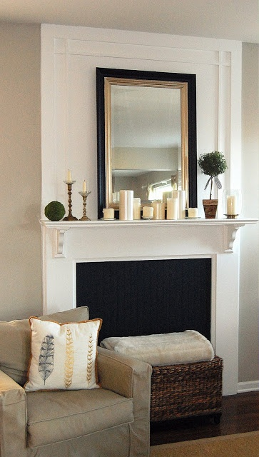 ... image of grouped candles but notice all of the other elements that are  brought in from sconces flanking the mirror to art leaned up against the  mantle.