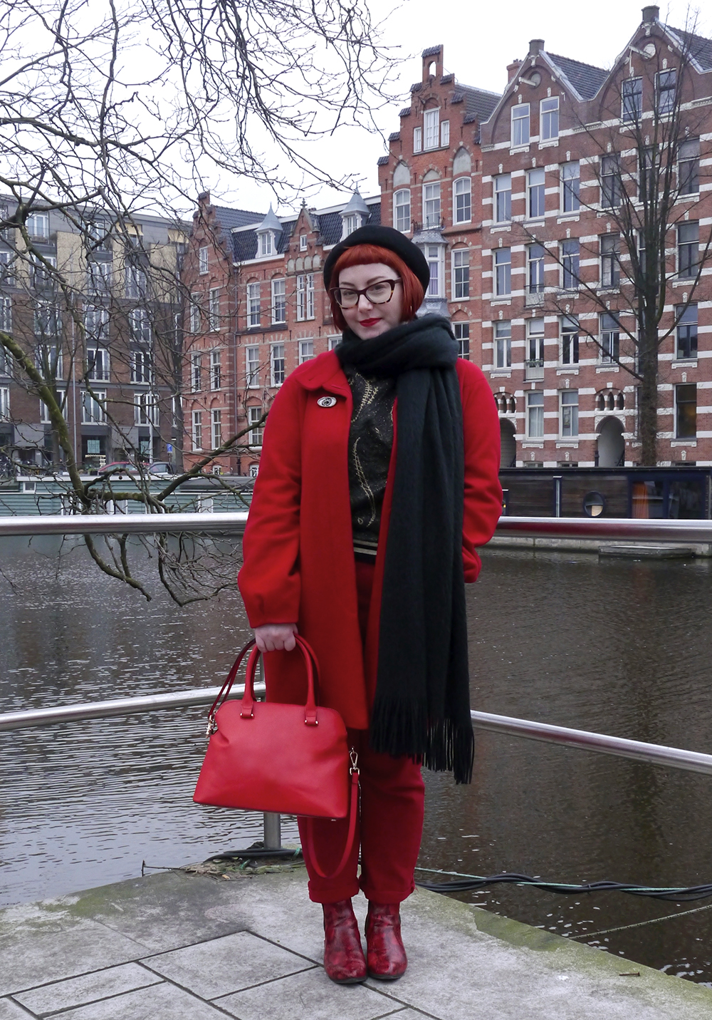 Bright red outfit for a grey Amsterdam day