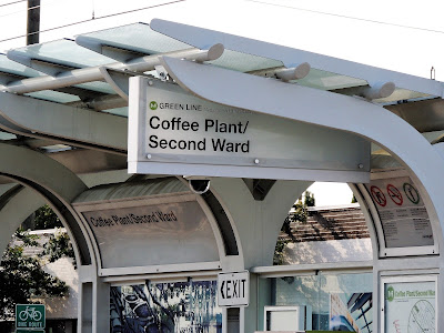 Light Rail Stop at Coffee Plant / Second Ward