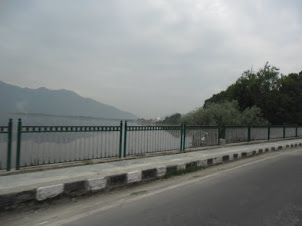 Crossing the Dal Lake bridge in Srinagar city.