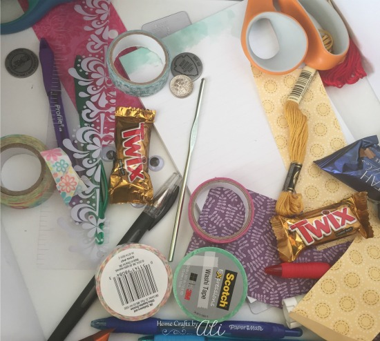 crafting items pens snacks in crafty junk drawer