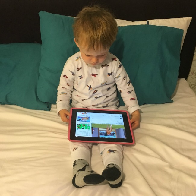 mishaps-and-mayhem-toddler-on-bed-with-ipad