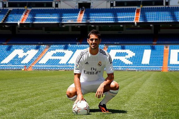 New Real Madrid signing Isco poses for photographers during his official presentation