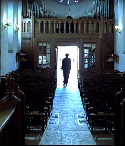 Man walking out of a church alone