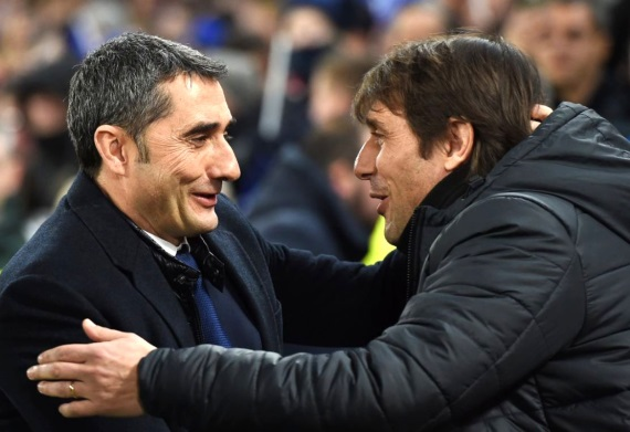 Ernesto Valverde and Antonio Conte greeting each other