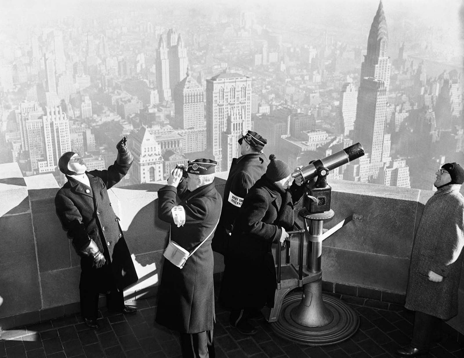 A crew of observers on the Empire State building, during an air defense test, on January 21, 1941 in New York City, conducted by the U.S. Army. Their job was to spot