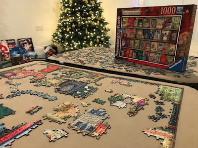 Doing a Christmas jigsaw by the tree