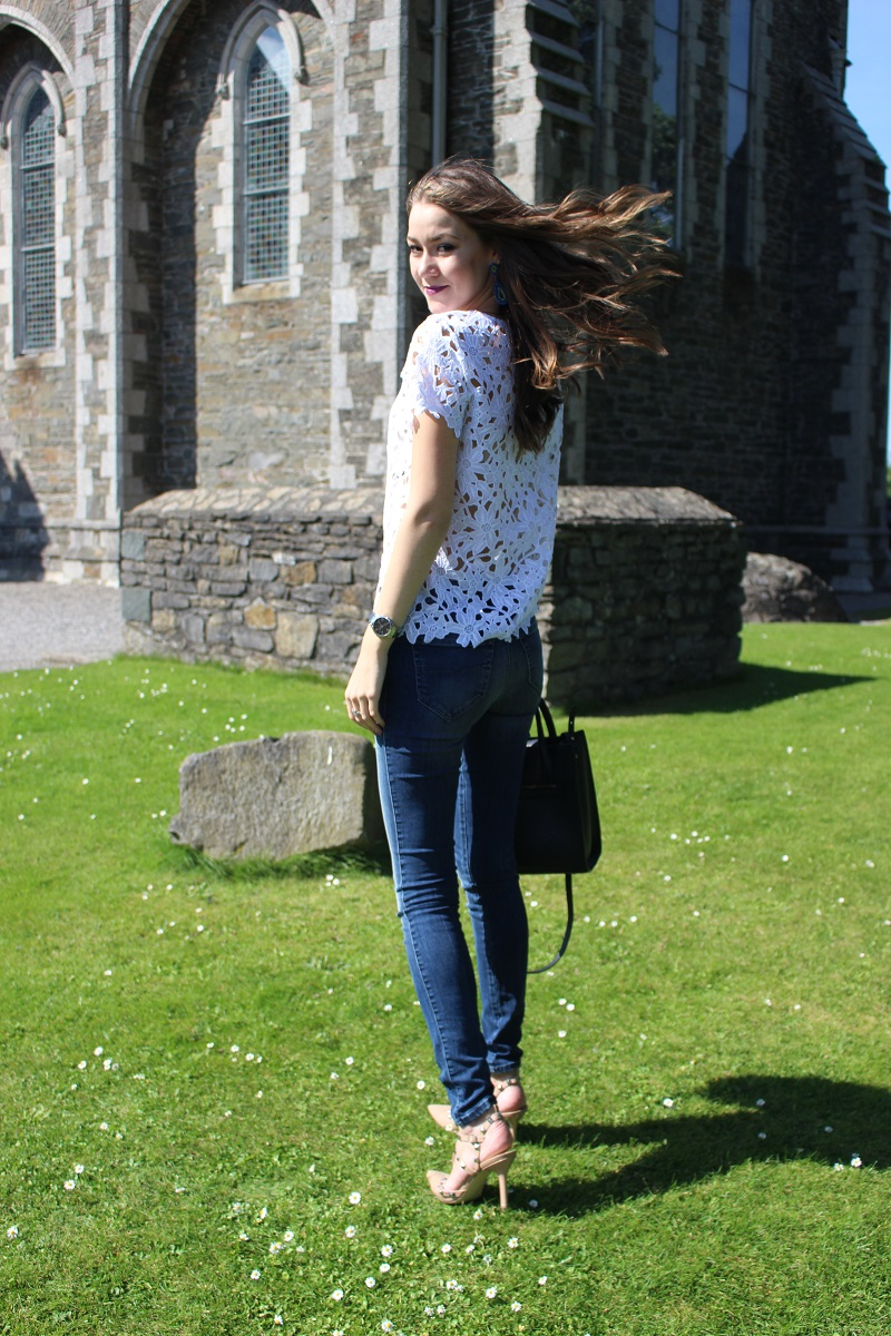 brunette, hair in wind, wind in hair, dark lips, crochet top, skinny jeans, heels