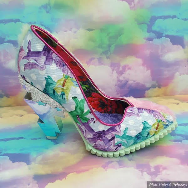 single shoes from side with mirrored lightning bolt heel and bright unicorn print upper