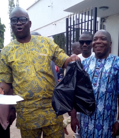 Drama as Fayose Storms Zenith Bank, Withdraws N5m From Frozen Account; See Photo