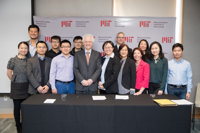 Image Attribute: MIT Associate Provost Richard Lester, center left; MIT associate professor Siqi Zheng, the founding faculty member of the China Future City Lab, center right; along with MIT staff and researchers, at the lab's launch event, November 17, 2017. / Source: MIT News Office