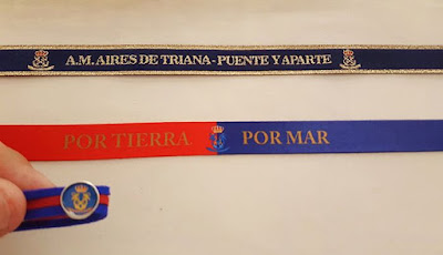 Pulseras de calidad artesana hechas en Sevilla por parte de La Caja Cofrade para la A.M. Aires de Triana tanto pulseras de tela bordadas como pulseras de tela impresas y pulseras de tiras de antes personalizables