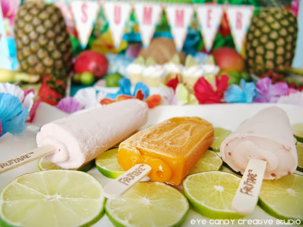 Fruttare bars, sliced limes, pineapple, tropical fruit, luau party food