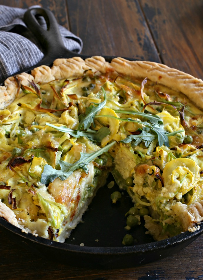 Cheesy savory tart filled with asparagus, peas and yellow squash.