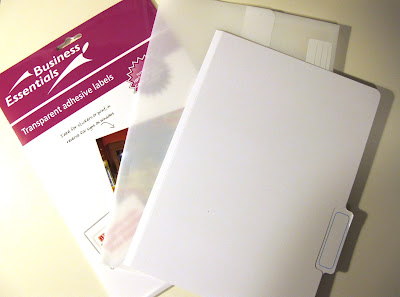 A packet of A4 clear printable stickers and a white plastic and white cardboard  folder.
