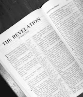 a photo of the first page book of Revelation in the New Testament of the Bible