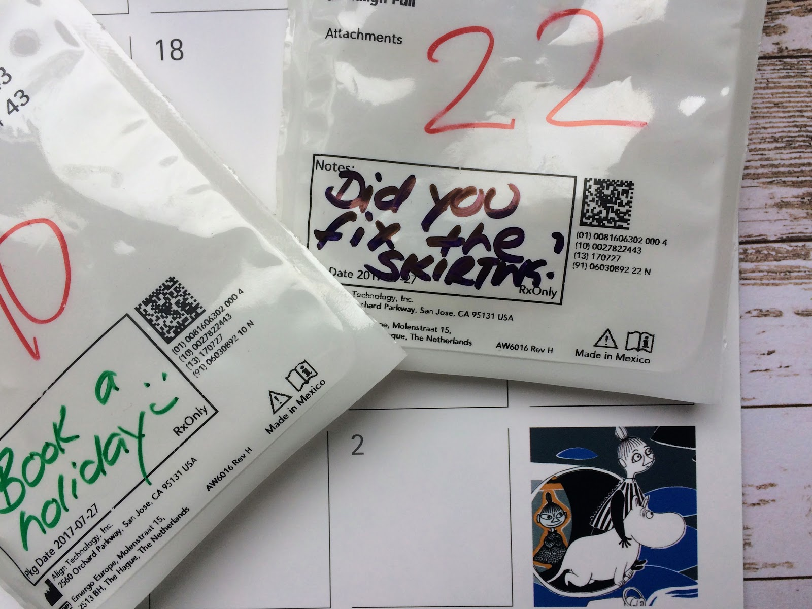 Invisalign packet with notes and a 2018 moomin calendar