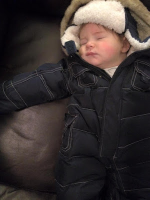 baby sleeping in snow suit