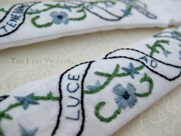 close up embroidery blue flower garters