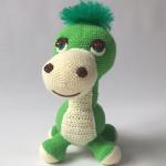 http://www.haakjemee.nl/crochet-pattern-dinosaur/