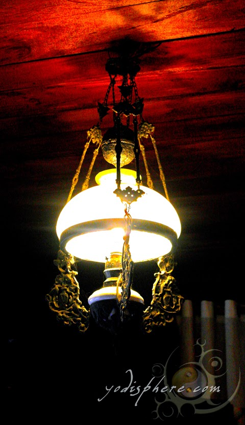 hover_share Antique Spanish lamp hanging from the ceiling of Casa de Don Emilio house