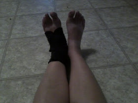 light tan feet, the left one has a black ankle brace