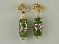 http://www.thecliponearringstore.com/fancy-black-lamp-work-glass-bead-clip-on-earrings.html