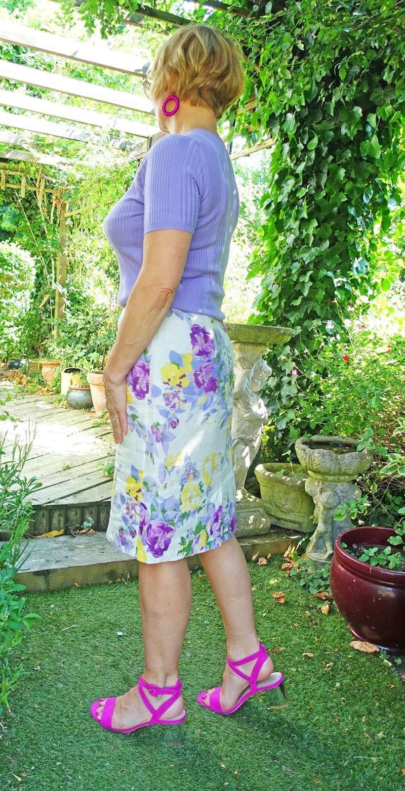 Lilac floral skirt worn with a lilac top and pink sandals