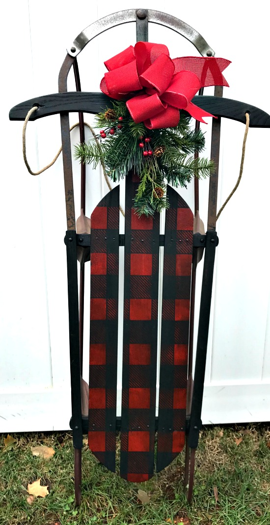 Red and Black Buffalo Check Sled with wreath and bow.